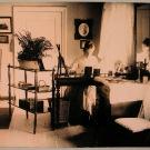 Баронесса Софья Николаевна фон дер Пален (урожд. Николаи) за столом в кабинете усадебного дома