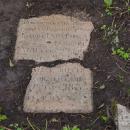 Ратчино, осколки плит надгробий возле Георгиевской церкви